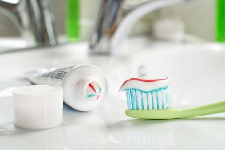 Toothbrush with fluoride toothpaste on it