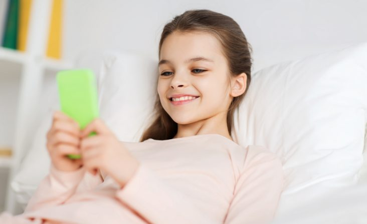 child playing with a oral dental app