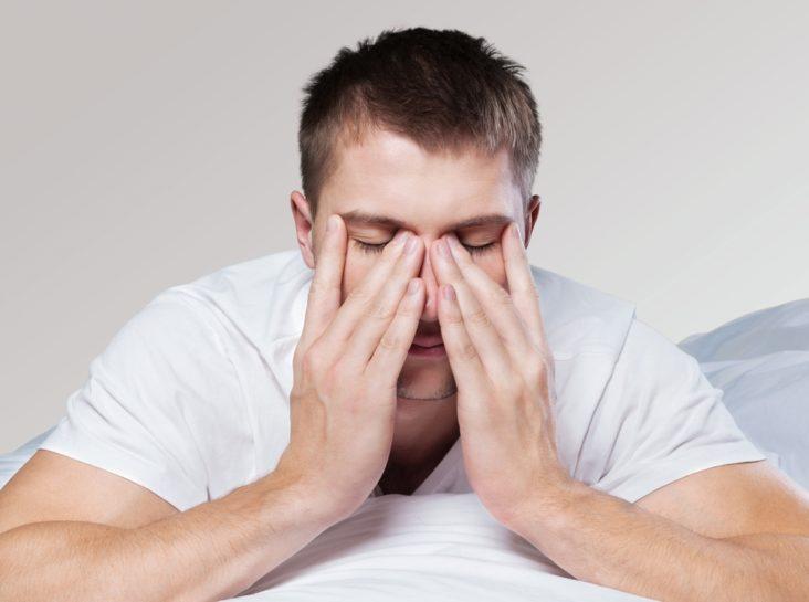 A tired man rubs his nose - CPAP vs dental appliances
